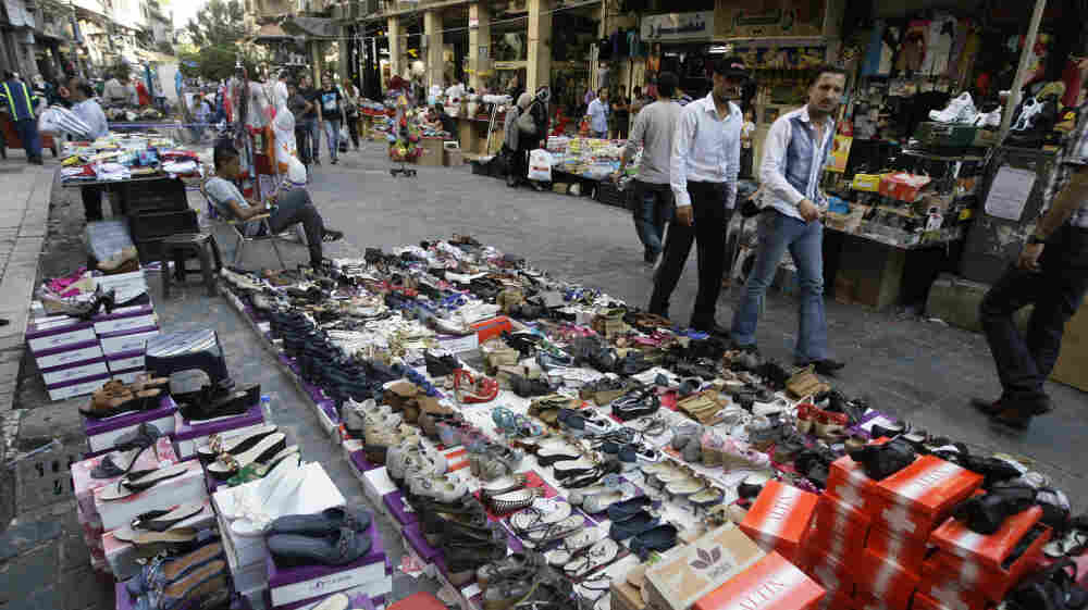 Syrian street vendors display their goods in downtown Damascus on Tuesday. Syria's economy was hit hard initially by the anti-government uprising. It has bounced back, but now the U.S. is urging the European Union to join in banning imports of crude oil from Syria.