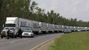 A convoy of Walmart trucks waited to enter New Orleans on Sept. 1, 2005, after the city was battered by Hurricane Katrina. Government agencies said the massive storm taught them that big-box retailers need to be an integral part of hurricane preparation and relief efforts.