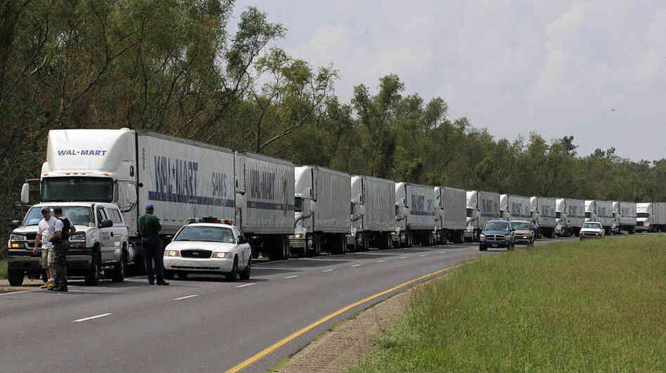 A convoy of Walmart trucks waited to enter New Orleans on Sept. 1, 2005, after the city was battered by Hurricane Katrina. Government agencies said the massive storm taught them that big-box retailers need to be an integral part of hurricane preparation and relief ef