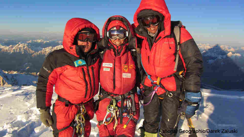 Maxut Zhumayev of Kazakhstan (left), Gerlinde Kaltenbrunner of Austria and Vassiliy Pivtsov of Kazakhstan pose for a photo after reaching the top of K2. Each of the three alpinists now have summited all of Earth's 14 major peaks without using supplementary oxygen.