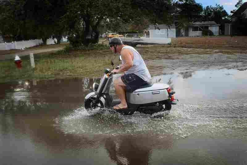 Some flooding is no match for a scooter ride in Kill Devil Hills, N.C., on Sunday.