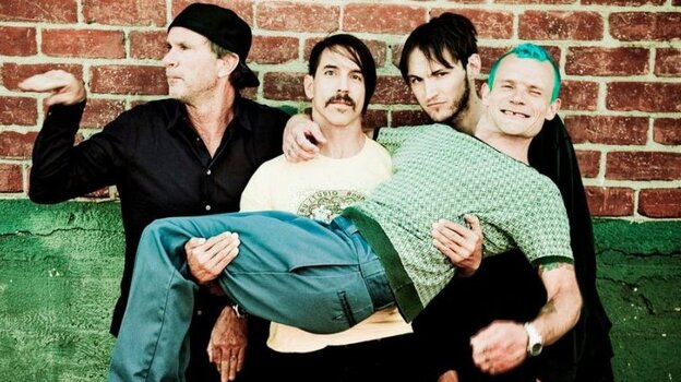 Red Hot Chili Peppers, left to right: drummer Chad Smith, lead singer Anthony Kiedis, new guitarist Josh Klinghoffer, bassist Flea.