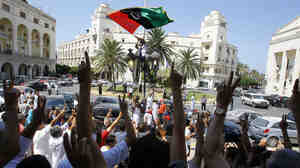 Libyans show their support for the rebellion after Friday prayers near Green Square