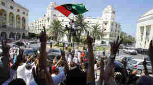 Libyans show their support for the rebellion after Friday prayers near Green Square in Tripoli.