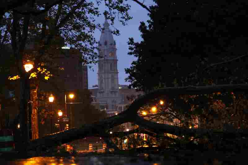 A downed tree blocks a section of the Benjamin Franklin Parkway leading to City Hall in Philadelphia.