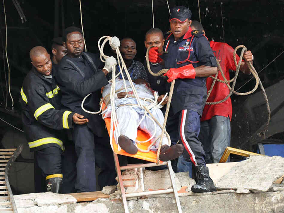 Rescue workers evacuated a wounded man earlier today (Aug. 26, 2011) from the U.N. building in Abuja, Nigeria.