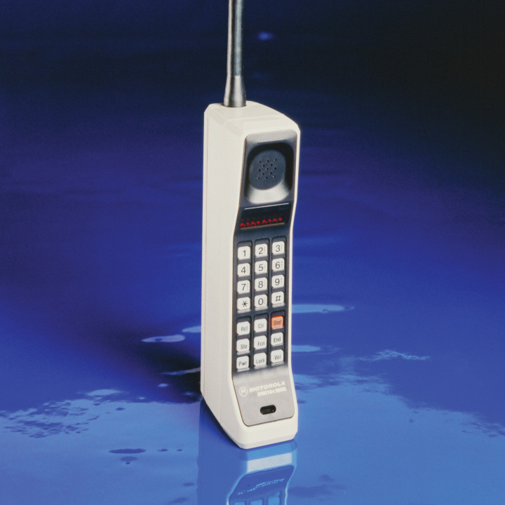 The first handheld cell phone, the Motorola DynaTAC 8000X. Motorola's Martin Cooper made the first handheld cell call in 1973 -- to inform one of his competitors of his breakthrough.