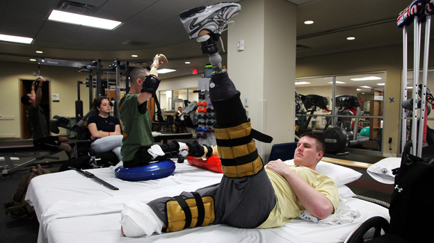 Tyson Quink exercises at the National Naval Medical Center in Bethesda, Md. Quink, a former college football player, lost both of his legs three months into his deployment to Afghanistan. (NPR)