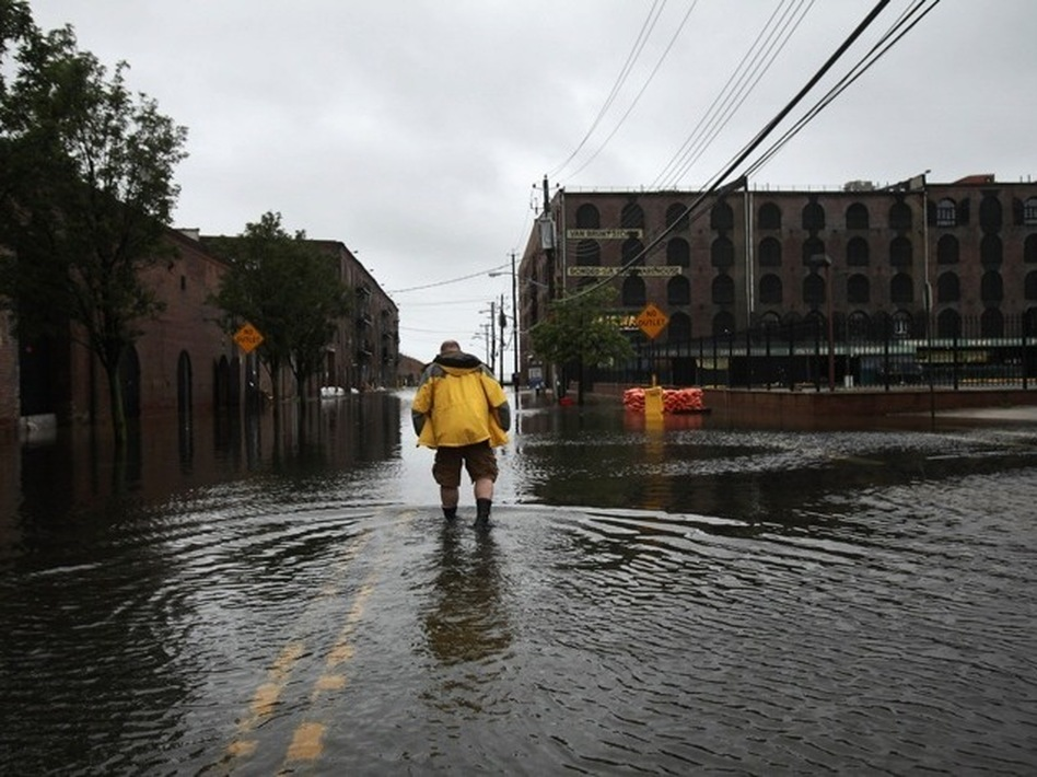 Water sits on the streets of Brooklyn's Red Hook neighborhood on Sunday. (Spencer Platt/Getty Images)