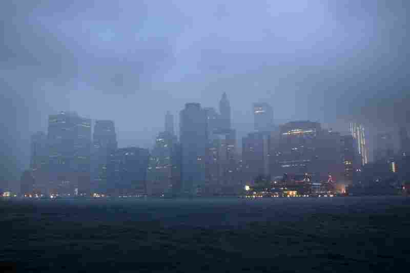 Lower Manhattan sits amid dark clouds as Irene bears down on New York early Sunday, bringing winds and rapidly rising seawater that threatened parts of the city.