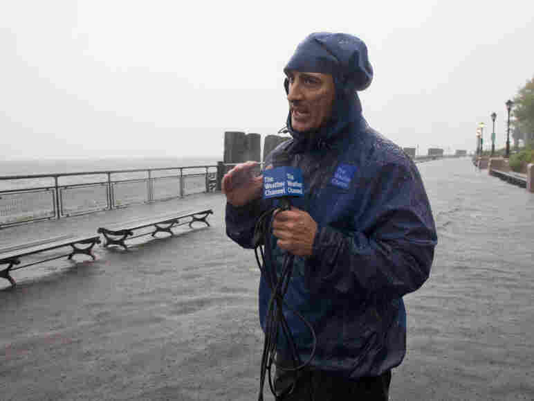 In this handout image provided by The Weather Channel, Jim Cantore reports on Hurricane Irene from Battery Park on Sunday.