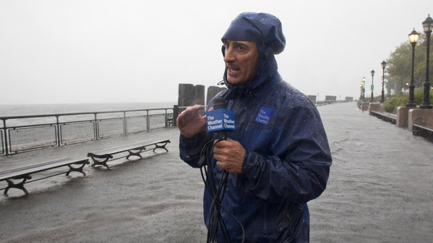 In this handout image provided by The Weather Channel, Jim Cantore reports on Hurricane Irene from Battery Park on Sunday. (Getty Images)