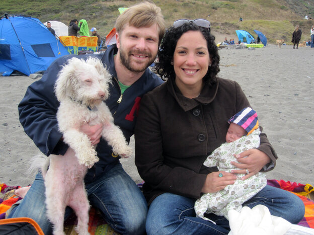 Matt, Loriani and Valentina Eckerle spend some time on the beach. Both mom and dad are pitching in equally, six weeks after their baby was born.