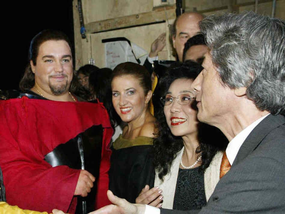 Japanese Prime Minister Junichiro Koizumi (right) greets Salvatore Licitra (left) and fellow cast members at La Scala in this 2003 file photo.
