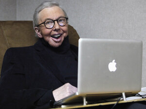Pulitzer Prize-winning movie critic Roger Ebert works in his office at the WTTW-TV studios in Chicago in January 2011.