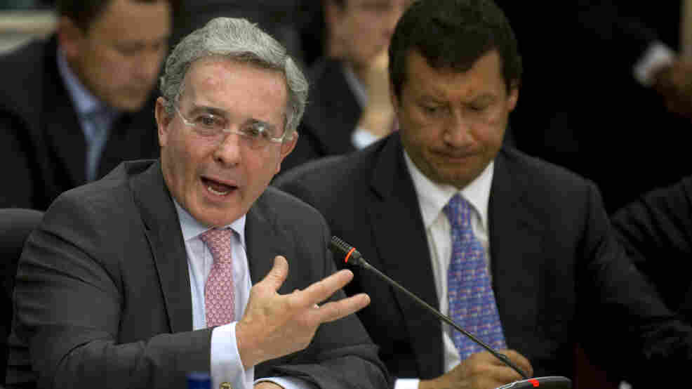 Former Colombian President Alvaro Uribe (left) speaks during a public congressional hearing in Bogota earlier this month about allegations that the country's intelligence service spied on high court judges during his government.