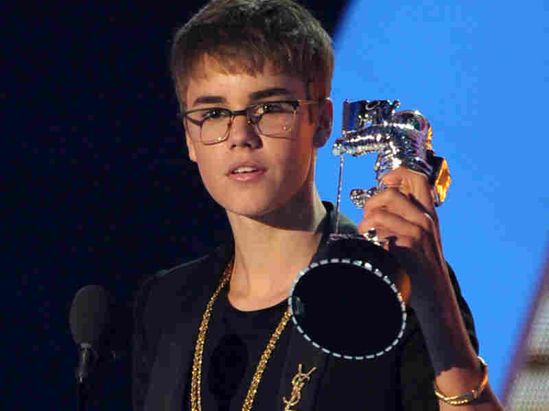"Justin Bieber received the Best Male Video award and looked bored the entire time. Perhaps the best Bieber tweet came from writer Christina Kinon, who said, ""Justin Bieber is slowly morphing into Ms. Kremens, my high school lacrosse coach."""