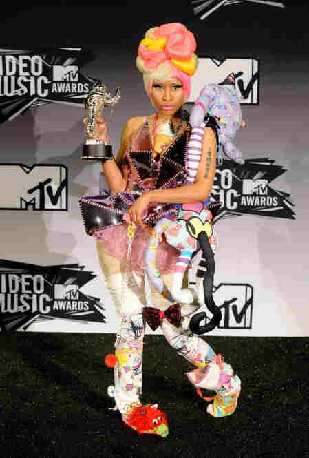 "This is Nicki Minaj, who won the Best Hip-Hop Video Award for ""Super Bass."" For a woman wearing so many slippers, she doesn't look very comfortable."