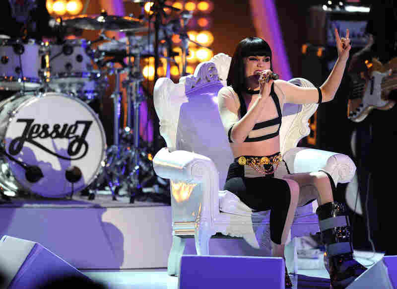 Singer Jessie J, stuck with a bum foot and therefore seated all night, served as the entertainment heading in and out of commercial breaks.