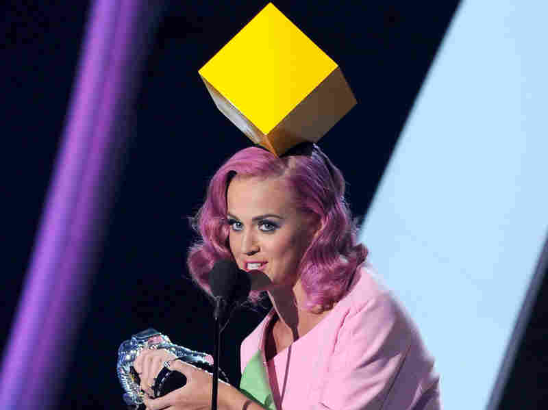 Singer Katy Perry accepted the Video Of The Year award with a giant yellow block on her head. Make of it what you will.