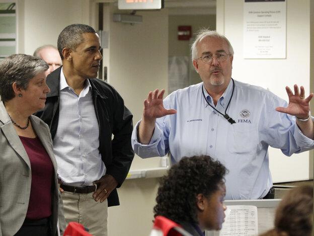 President Obama and Homeland Security Secretary Janet Napolitano listen to Craig Fugate, FEMA director, Aug. 27, 2011.