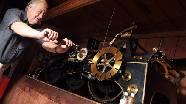 Paul Fisher, winds by hand the world's oldest continually working mechanical clock for the very last time on August 21, 2010 in Wells, England. The clock in Somerset's Wells Cathedral had been wound by hand since it was first installed in the 1380s.