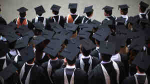 BIRMINGHAM, ENGLAND - JULY 14:  Students pose for their official group photograph at the University of Birmingham as they take part in their degree congregations on July 14, 2011 in Birmingham, England.