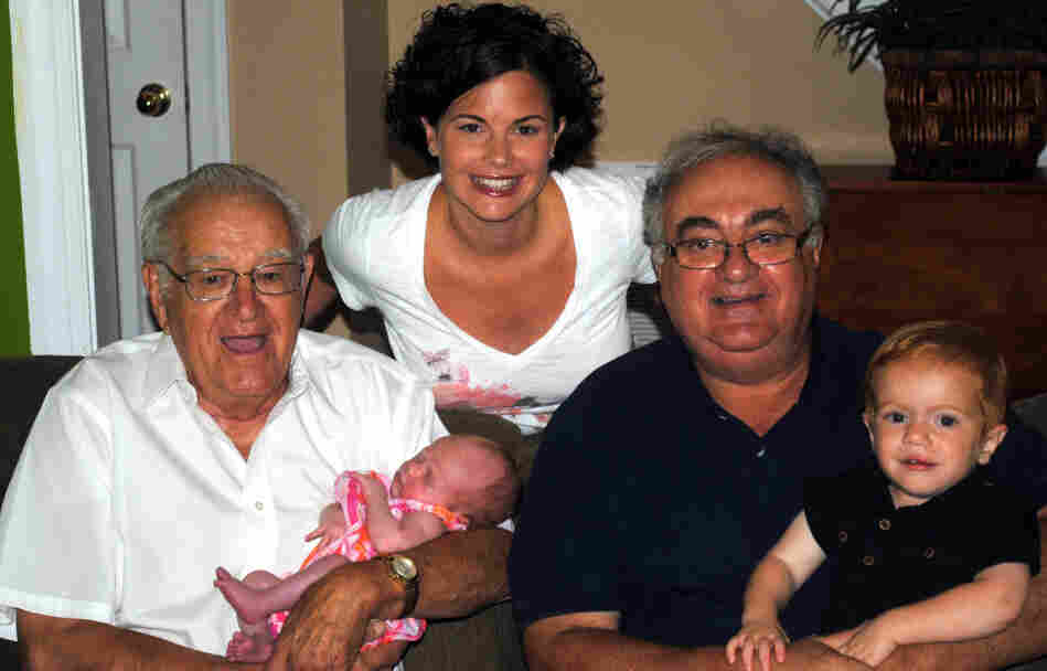Four generations (Christy, her grandfather, father and children) gather for a snapshot.