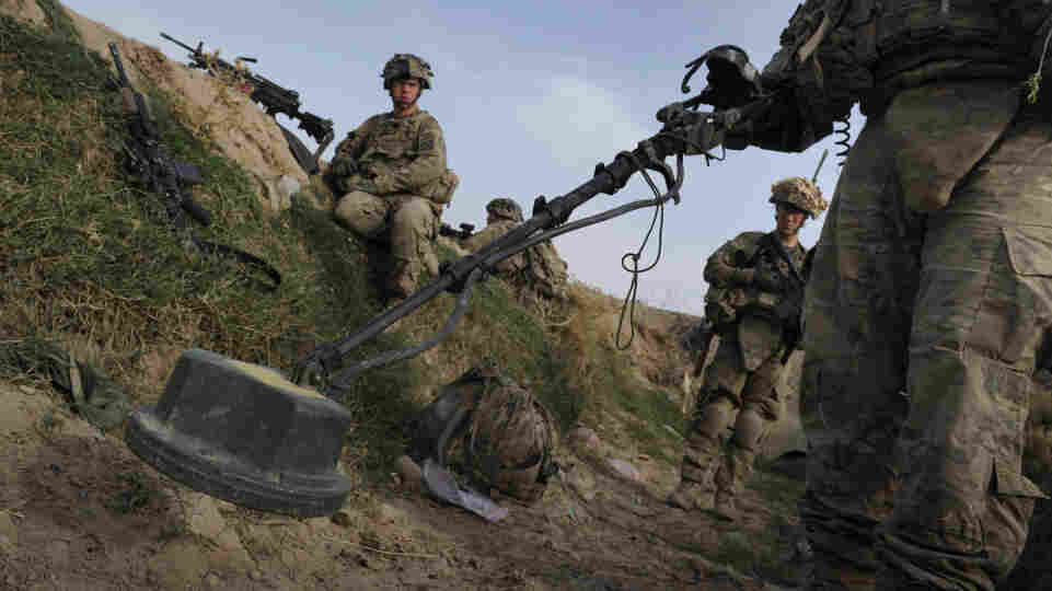 U.S. soldiers check for land mines on a canal running through Highway 1 in Afghanistan's Kandahar province, Aug. 6. Improvised explosive devices, or IEDs, are the Taliban's weapon of choice and are the leading killer of civilians and soldiers in Afghanistan.