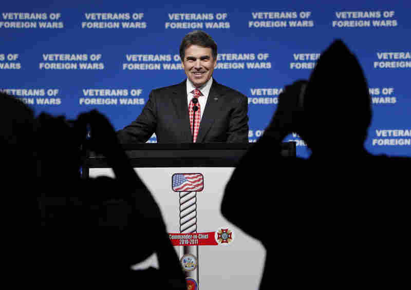 Republican presidential candidate Rick Perry is photographed by attendees as he addresses the VFW convention on Monday.