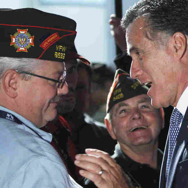 Republican presidential candidate Mitt Romney greets veterans after addressing the national conference of the Veterans of Foreign Wars on Tuesday in San Antonio.
