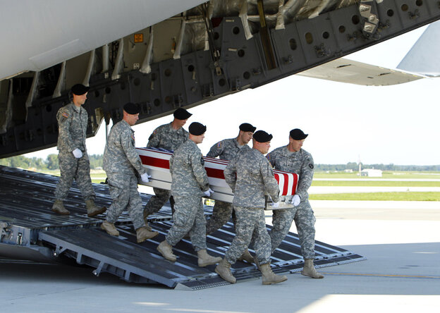 An Army carry team moves a transfer case containing the remains of  Spc. Michael C. Roberts during a dignified transfer ceremony at Dover Air Force Base, Del., on Tuesday.