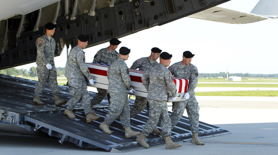 An Army carry team moves a transfer case containing the remains of  Spc. Michael C. Roberts during a dignified transfer ceremony at Dover Air Force Base, Del., on Tuesday. (AP)
