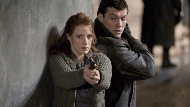 Settling A Tab? Rachel (Jessica Chastain, left) and David (Sam Worthington) are '60s-era Mossad agents in John Madden's thriller The Debt.