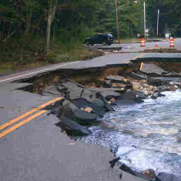 Roaring Brook flows onto Route 73 in Keene, N.Y., on Tuesday.