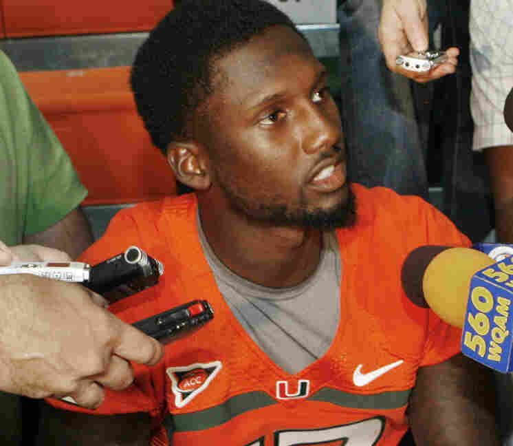 Miami quarterback Jacory Harris answers questions during  media day in Coral Gables, Fla. on Aug. 27, 2011.