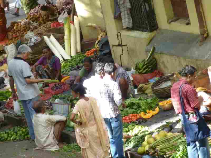 Shoppers pick out vegetables at a bazaar in Calcutta, India.