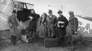 It's an age old question: What's the easiest way to board a plane? In this 1933 picture, passengers wait to board a new passenger service between London and Paris.