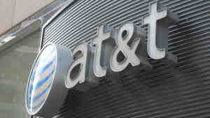 This June 2, 2010, file photo shows the AT&T logo in Washington, D.C. The U.S. Justice Department will seek to block AT&T's proposed $39 billion acquisition of T-Mobile.
