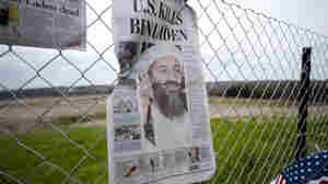 A newspaper left by visitors on May 2 in Shanksville, Pa., at the fence surrounding the crash site of Flight 93. The chairmen of the 9/11 Commission say the U.S. has improved security over the past decade, but gaps in the system remain.