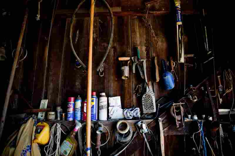 Farm tools line the walls of Bowling's barn. He prides himself on keeping his old tractor repaired and tending to his customers' needs.