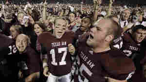 In this Nov. 20, 2010 file photo, Texas A&M  quarterback Ryan Tannehill (17) and Evan Eike (65) celebrate with fans after beating Nebraska 9-6 in an NCAA college football game in College Station, Texas.