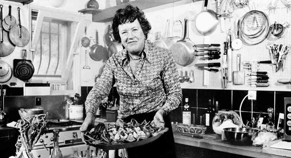"Bon Appetit: Chef Julia Child shows off a salade nicoise she prepared in the kitchen of her vacation home in southern France, in August 1978. Child remembered the first French dinner she had, back in 1948: sole with mushroom and white wine sauce, and oysters on the half shell. ""I just couldn't get over it,"" she told Terry Gross. ""I hadn't ever had that kind of food."""