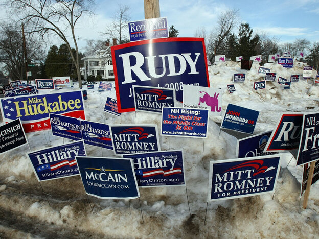 Campaign posters are seen in a snowbank outside a polling place in January 2008 in Manchester, N.H.