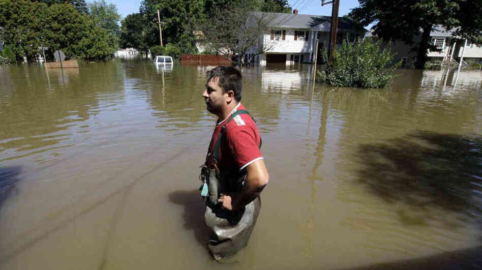 In Pompton Lakes, N.J., earlier this week, Gino Borova stood in the driveway of his house — which was flooded by water from the Ramapo River.