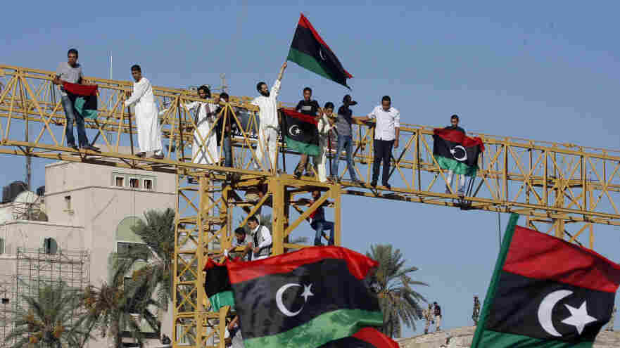 Libyans wave national flags in Tripoli's Green Square, renamed Martyr's Square, during morning prayers Wednesday on Eid al-Fitr, the holiday marking the end of Ramadan. Libyans are also celebrating the ouster of Moammar Gadhafi.