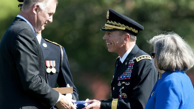 Deputy Defense Secretary William Lynn (left) presents Gen.  David Petraeus with an American flag at his retirement ceremony after 37 years in the Army, in Arlington, Va., on Wednesday. Petraeus will now lead the CIA. (AFP/Getty Images)