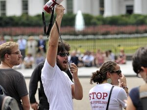 A protester uses a megaphone to shout slogans in front of the White House on Aug. 26, 2011. Demonstrators protested against the proposed Keystone XL oil pipeline project which, if approved, would run from Alberta, Canada to Texas through environmentally sensitive areas.