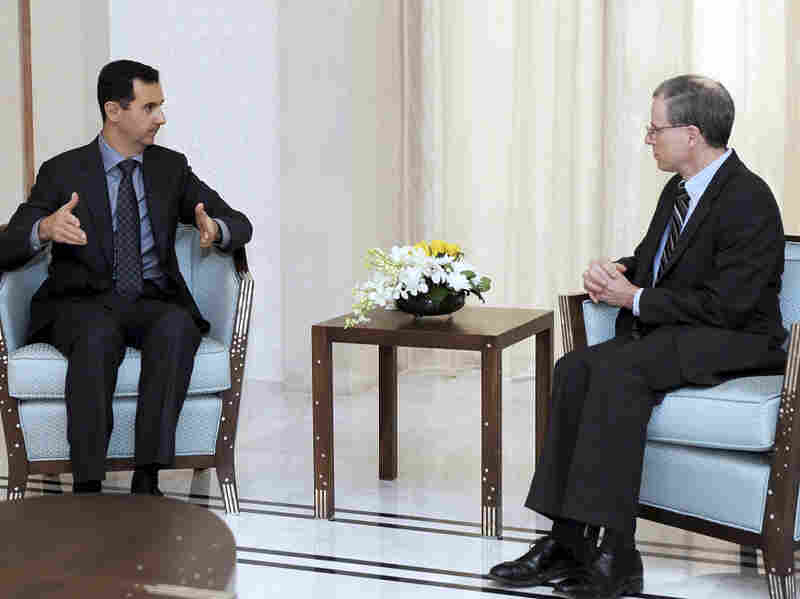 Syrian President Bashar Assad, left, meets with Robert Ford, the U.S. ambassador to Syria, in Damascus, Jan. 27, 2011. Ford is the first American ambassador to Syria since 2005.