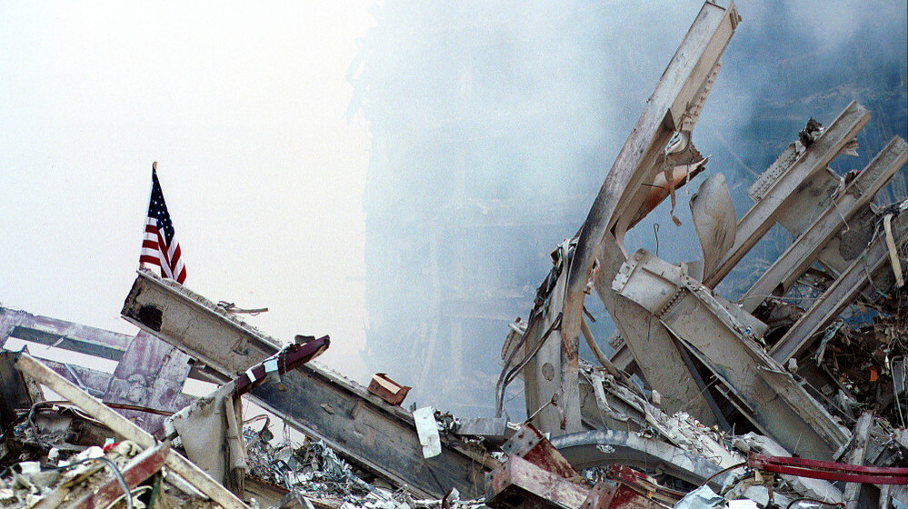 Sept. 13, 2001: An American flag, put there by rescue workers, stands in the wreckage of the World Trade Center.
